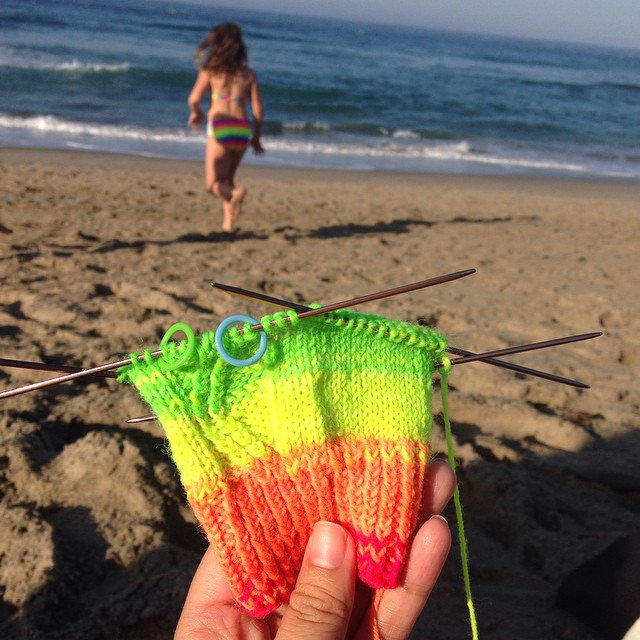 Took my Zigzagular socks to the beach while waiting for my friend to finish his Triathalon. #knitting #zigzagularkal #neon #operationsockdrawer