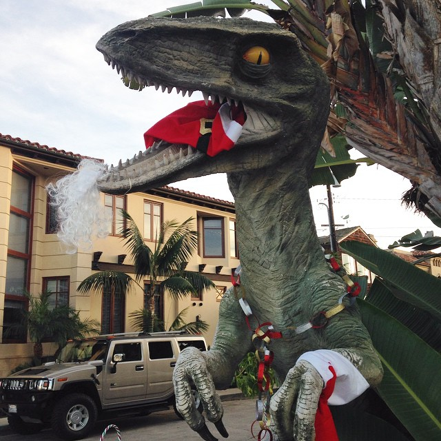 Favorite thing I saw today was this house with a #christmas raptor in front. It was big and bizarre and totally awesome. #jurassicpark #dinosaur look @kimberlybuggie